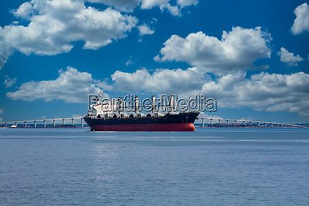 empty freighter by white bridge