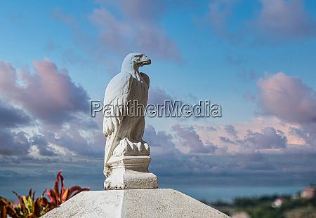 stone eagle by sea at dusk