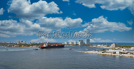 freighter and tugboat leaving harbor