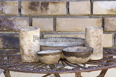 clay pots on a metal table