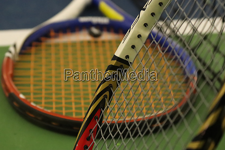 two tennis rackets on playground court