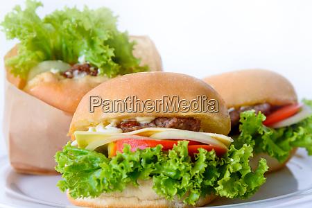 group of three hamburger on a