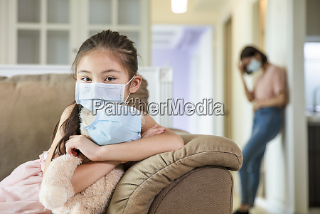 child and mother in medical masks