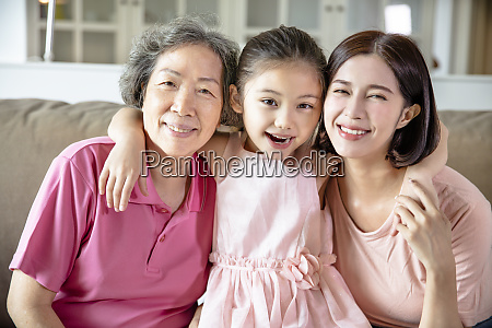 happy grandmother and daughter with granddaughter