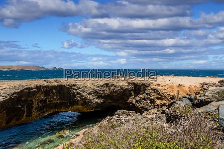 natural bridge over blue sea