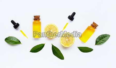 essential oil with lemon on white