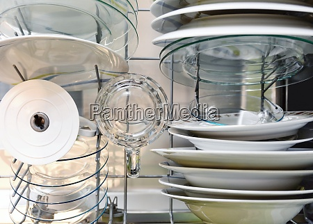 cleaned dishes in dishwasher rack top