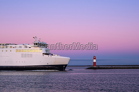 mole and ferryboat on shore of