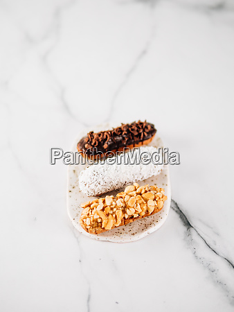 healthy eclairs or profitroles on marble