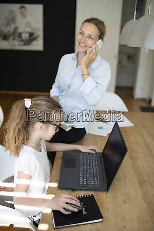 pretty young business woman works from