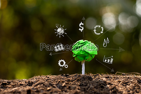 green recyclable paper trees on the