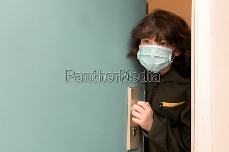 a boy in a surgical mask