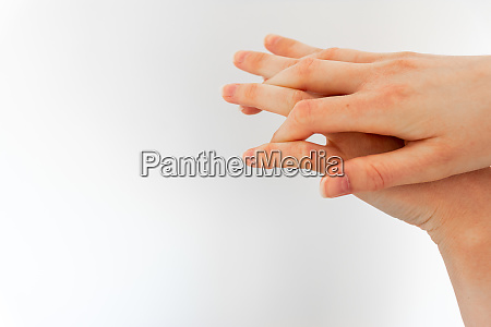 woman washing hands with hand sanitizer
