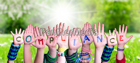 children hands building word compliance grass