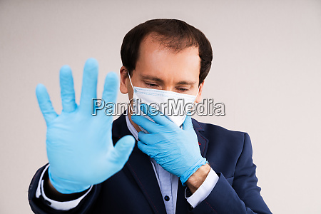 man in mask suffering from panic