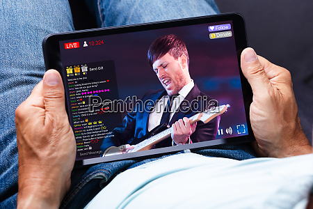 man holding digital tablet with doctors