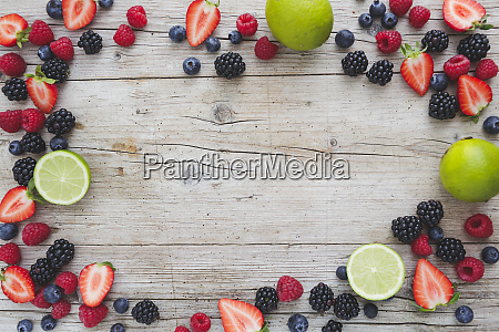 many fresh strawberries rasperries blueberries and