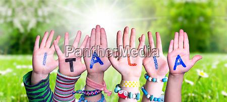 children hands building word italia means