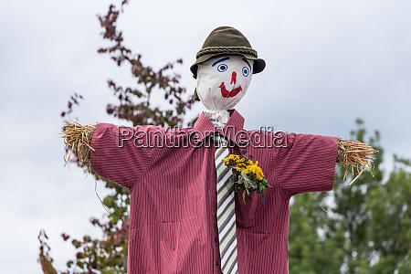 scarecrow and garden decoration