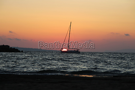 a, sailing, boat, in, the, sunset - 28424439