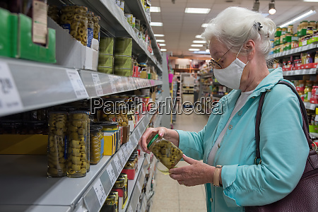 senior woman with protective mask in