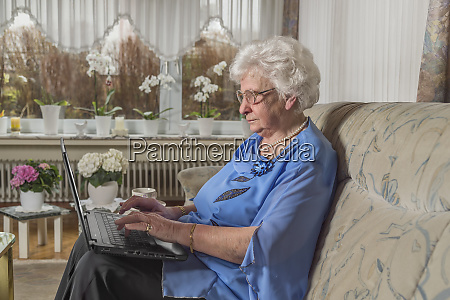 80 year old woman sitting alone