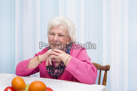 80 years old woman sitting alone