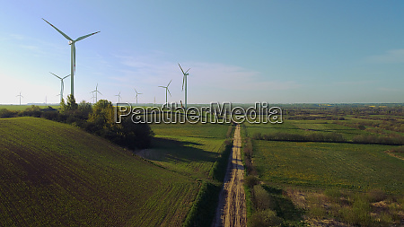 wind farm towers surrounded by agricultural