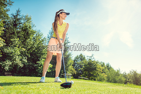 beautiful woman on golf course at
