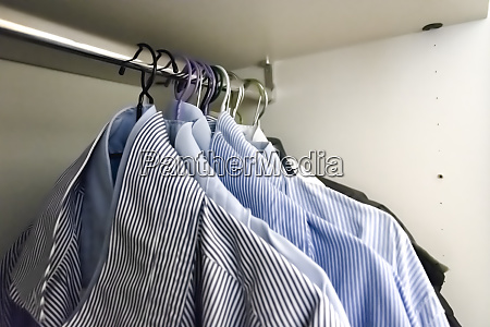 a group of mens shirts in