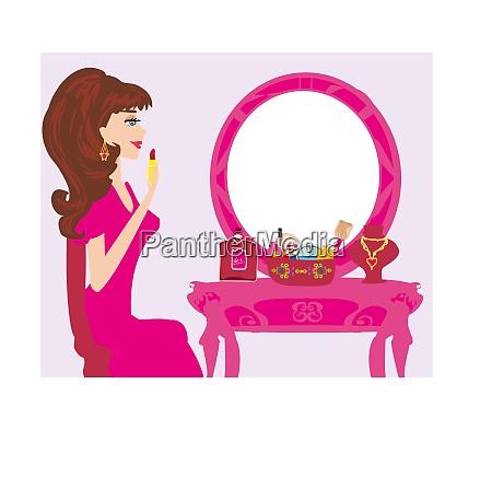 beautiful woman putting lipstick on