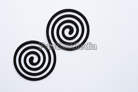 black spiral mosquito repellent coils on