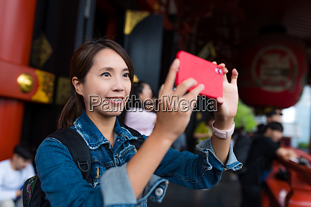 woman take photo in japanese temple