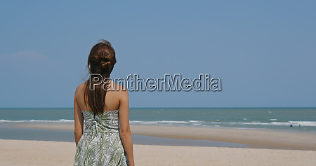 beautiful woman on sandy beach
