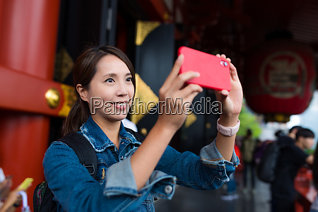 woman take photo on cellphone in