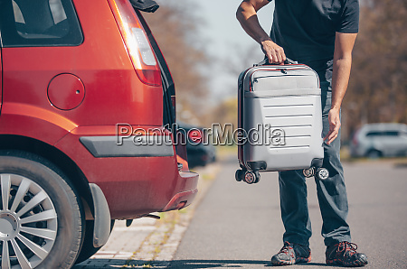 man getting ready for holiday vacation