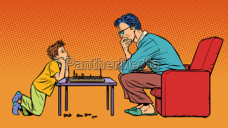 father and son play chess
