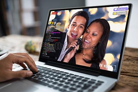cropped image of businessman using laptop