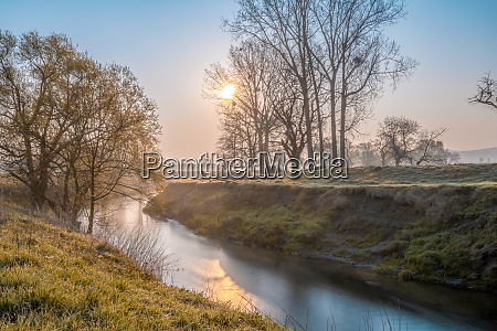 river in colorful atmospheric sunlight mood