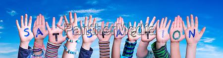 children hands building word satisfaction blue