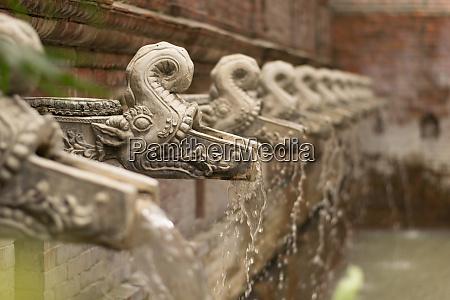 traditional nepali water taps shaped like