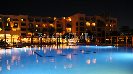 swimming pool and night hotel on