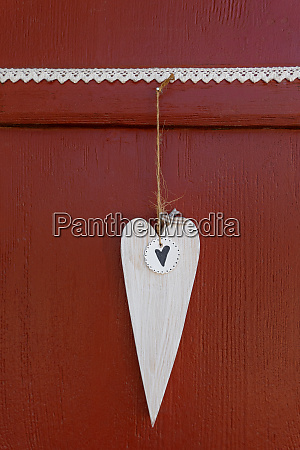 white wooden heart hangs on a