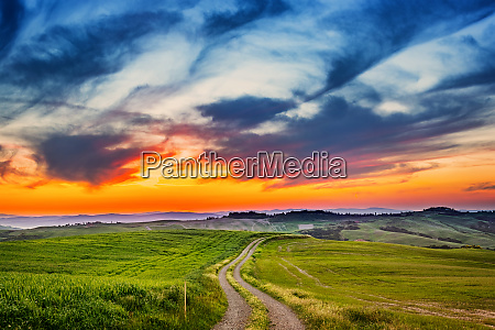 colorful tuscany landscape at sunset