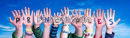 children hands building word principles blue