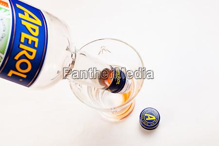 poiring of drops from bottle of