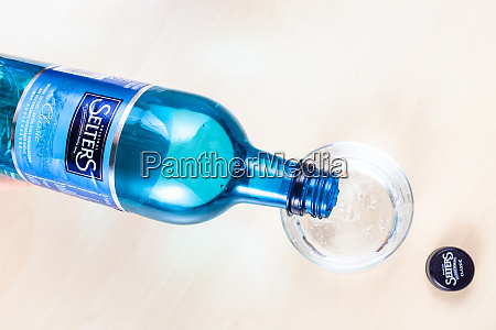 pouring water from bottle of selters