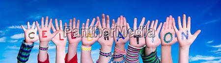 children hands building word celebration blue