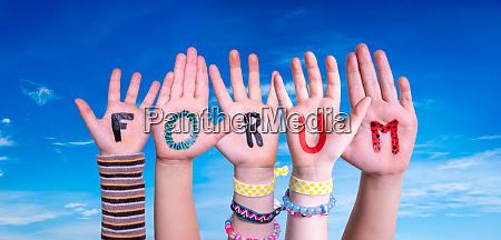children hands building word forum blue