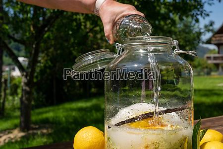 pour the vodka into the big